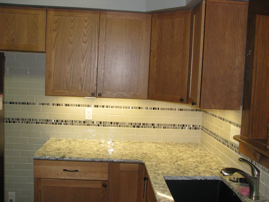 Amazing Morrison Kitchen With LED Under Cabinet Lighting, Cork Countertops And Tile  Backsplash