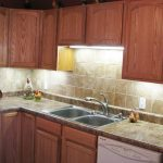 Rumsey kitchen remodel with tile backsplash & laminate counter tops