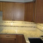 Morrison Kitchen With LED Under Cabinet Lighting, cork countertops and tile backsplash